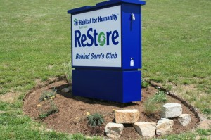 ReStore sign, rock and flower landscaping
