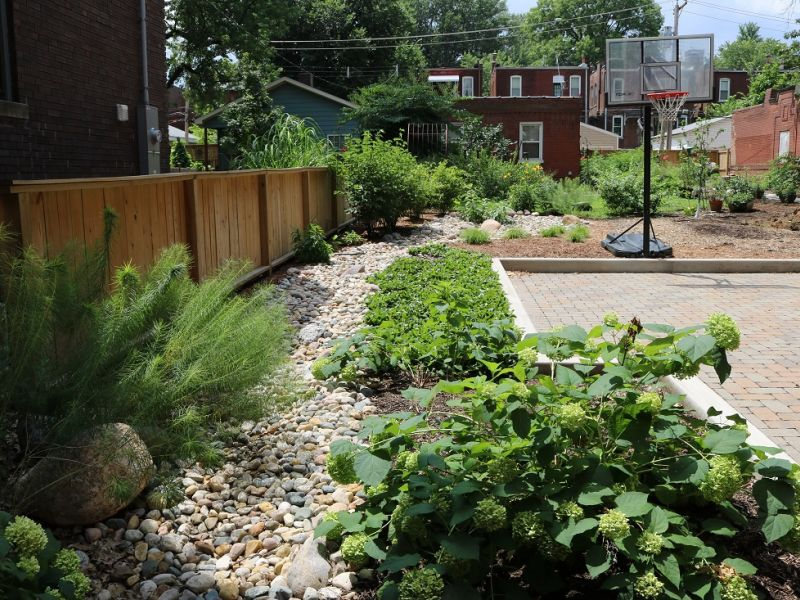 Permeable Pavers With Rain Garden